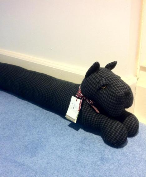 Keep out the draught with this quaint doggy draught excluder by Dora Designs from €39.95