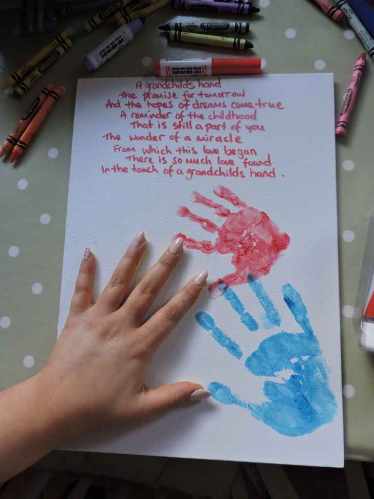 Sophie's handprint completes the canvas